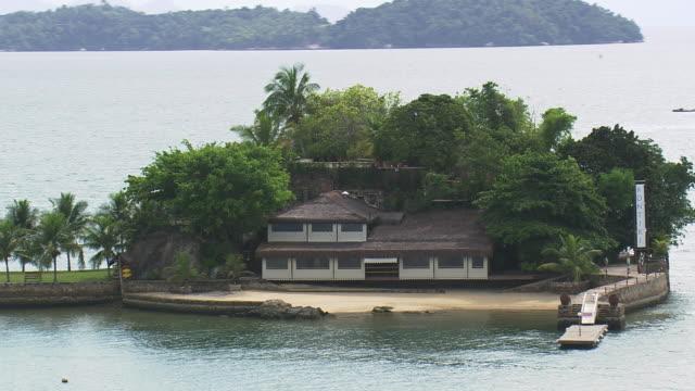 MS AERIAL TS Shot of single house on small island / Sao Paulo, Brazil