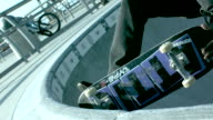 CU SLO MO Shot of skateboarder doing nose grab to tail slide / Venice, California, United States