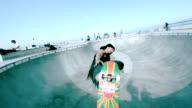 WS SLO MO Shot of skateboarder failed aerial trick in skate park bowl / Venice, California, United States