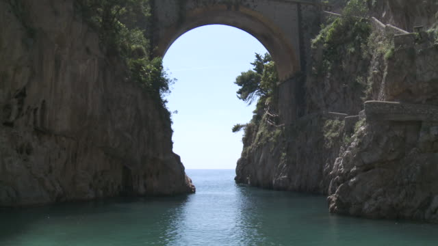 MS Shot of skyline on ocean through Fiordo di furore at Amalfi coast / Furore, Campania, Italy