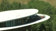 MS DS ZO Shot of sleeper house by architect charles deaton that is elliptical curved house built on Genesee Mountain / Denver, Colorado, United States