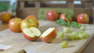 CU SLO MO Shot of sliced apple falling in to two pieces / United Kingdom