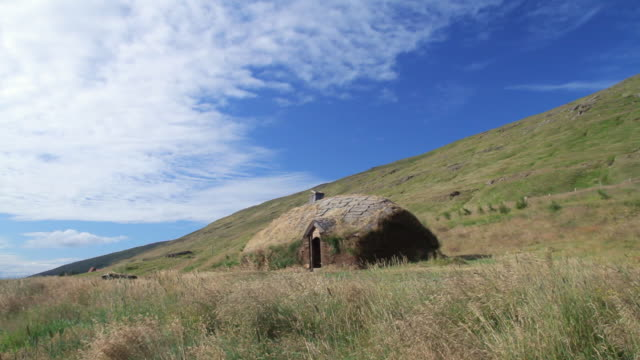 MS Shot of small house made of stone and rocks on hill with blue skies / Reykjavik, Hofudhborgarsvaedhi, Iceland