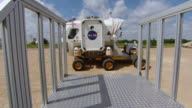 WS Shot of Small Pressurized Rover simulates docking with gate in training area at NASA Johnson Space Center / Houston, Texas, United States