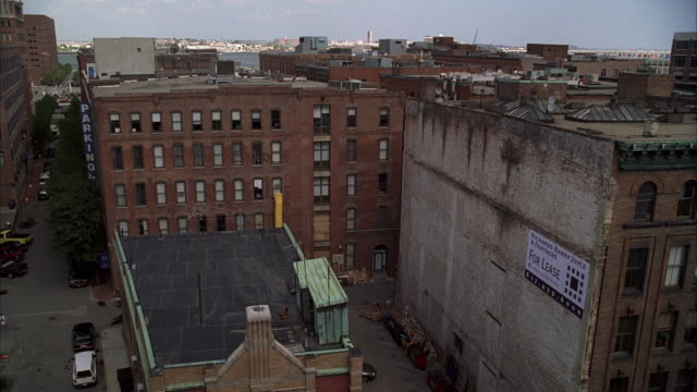 WS Shot of small street between old multi-story building / Unspecified