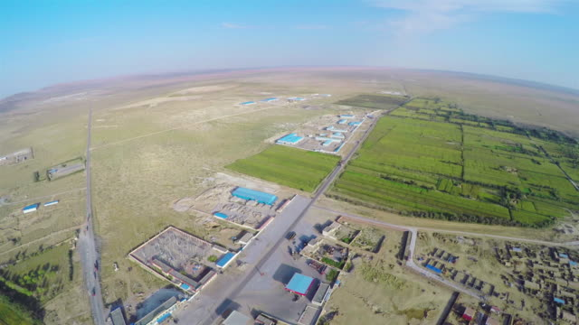 WS AERIAL Shot of small town in gobi dessert/Alashan,Inner Mongolia,China.