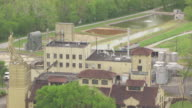 CU AERIAL DS ZO Shot of smoke stack and Four Roses Distillery / Kentucky, United States