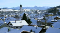 WS Shot of snow on roof on houses in town in winter / Nesselwang, Bavaria, Germany