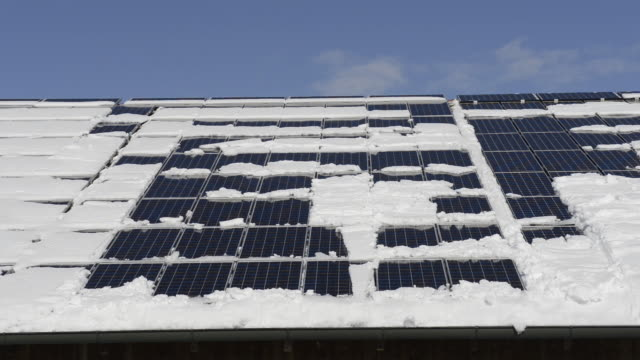 Ms Shot Of Snow Sliding Off Roof With Solar Panels