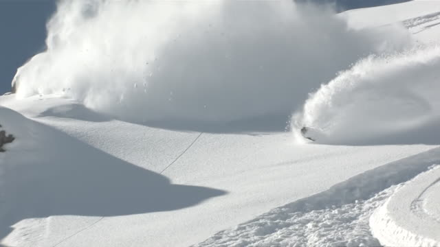 MS TS Shot of Snowboarding in deep poweder snow at Spectaculair jagged Mountain Peaks / Telluride, Telluride, United States Coloardo