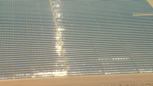 MS AERIAL Shot of solar panels in bright sunshine at Nevada Solar One solar power plant / Boulder City, Nevada, United States
