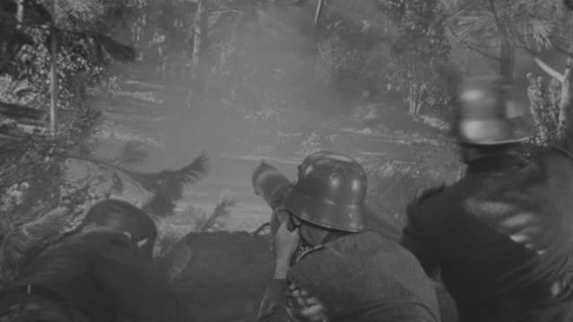 MS POV Shot of soldiers in machine gun nest during battle with explosions going off