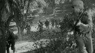 WS Shot of Soldiers running into forest under attack
