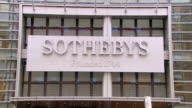 MS LA Shot of  Sotheby's headquarters sign on exterior of building / New York, United States