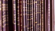 MS R/F Shot of Spines of religious texts written in Hebrew / London, United Kingdom