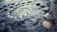 MS Shot of Spiral of rocks in river / Stone Ridge, New York, United States