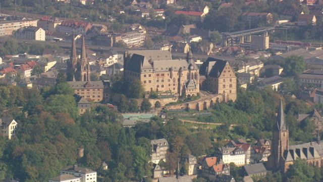 MS AERIAL Shot of St. Elizabeth Church and Marburg castle with other houses / Germany