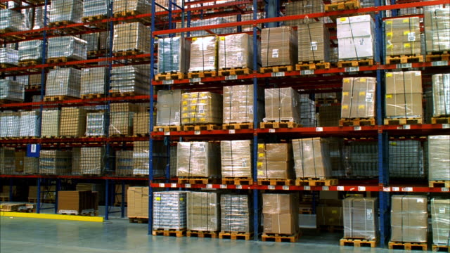 MS PAN Shot of stacks of pallets at warehouse / LeBec, California, United States