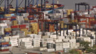 WS PAN Shot of stacks of shipping containers sit on docks on the Panama Canal / Panama