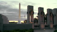 MS Shot of states pillars at World War II Monument with water fountain and Washington Monument / Washington, District of Columbia, United States