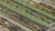 MS AERIAL TS ZO Shot of Stationary train at scaffolding at Bailey Train Yard / North Platte, Nebraska, United States