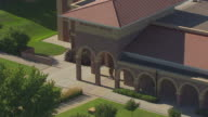 MS AERIAL TS ZO Shot of statue of George McGovern and pull out to McGovern Library / Mitchell, South Dakota, United States
