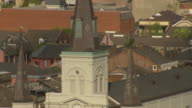 CU AERIAL TD Shot of steeple and st louis cathedral with courtyard / New Orleans, Louisiana, United States