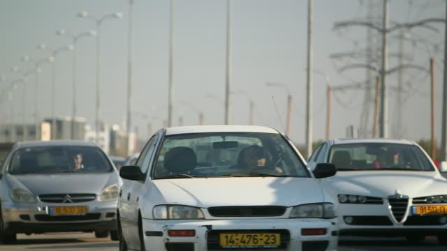 MS TD Shot of street lamps and traffic on highway / Tel Aviv, Israel