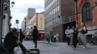 MS Shot of Street performer playing guitar on Temple Bar street / Dublin, Leinster,  Ireland
