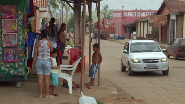 MS Shot of street shops in village / Serra Pelada, Para, Brazil