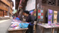 MS Shot of street vendor women / Yao Village, Huangluo, China