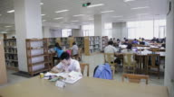 MS Shot of Students in Beijing University Library / Beijing, China