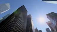 WS PAN LA Shot of sun above Park Avenue skyscraper / New York, United States