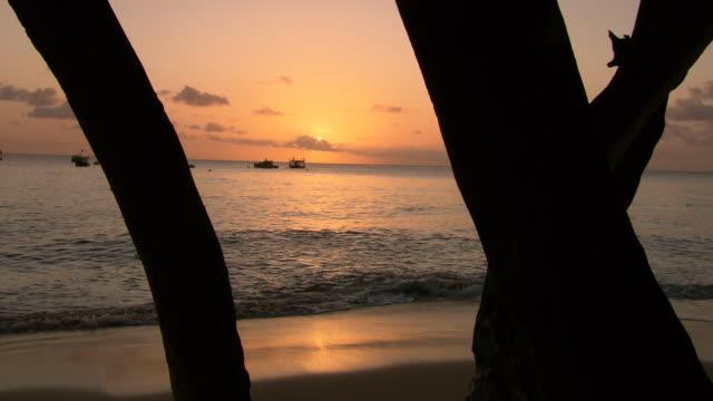MS Shot of Sunset and boat in sea / Bridgetown, Saint Michael, Barbados