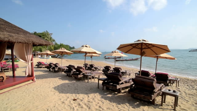 PAN Shot of sunshades and gazebo at sandy Bo Phut Beach