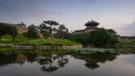 MS T/L Shot of Suwon Hwaseong Castles Banghwasuryujeong Lake and Building at sunset (UNESCO) / Suwon, Kyonggi-Do Province, South Korea
