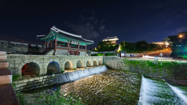 MS T/L Shot of Suwon Hwaseong Castles Hwahongmun Gate Building at night (UNESCO Heritage) / Suwon, Kyonggi-Do Province, South Korea