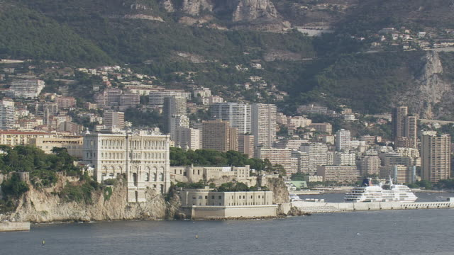 WS AERIAL Shot of tall buildings and hotels near coast / Monaco, France