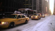 MS Shot of Taxi cabs on snowy street in Midtown Manhattan / New York, United States