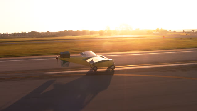 MS TS AERIAL Shot of Taylor aero car taking off from airport / Kissimmee, Florida, United States