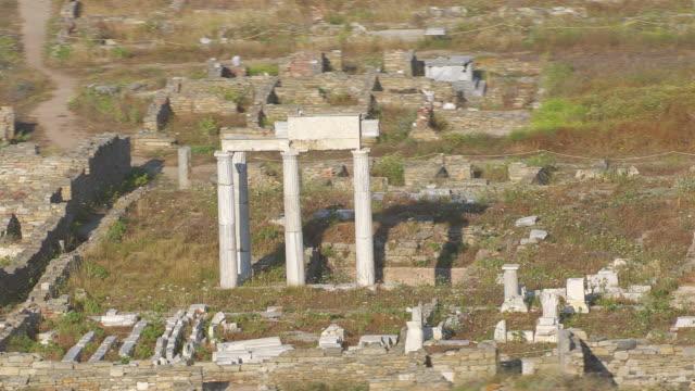 MS AERIAL ZO Shot of temple ruin of delos / Delos, Cyclades, Greece