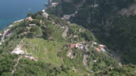 MS Shot of Terraced lemon grove and serpentine road near Tyrrhenian sea at Amalfi coast / Ravello, Campania, Italy