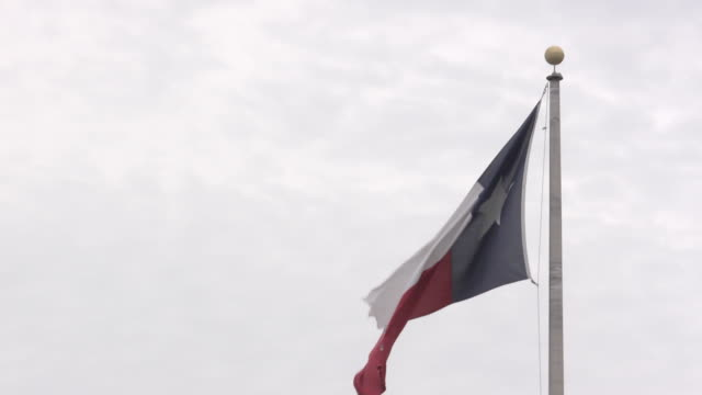 CU Shot of Texas flag blowing in wind / Austin, Texas, United States