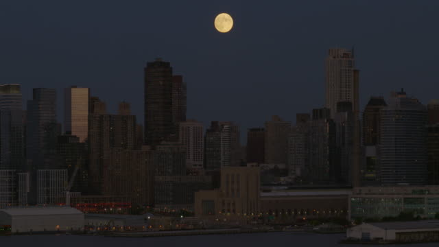 Shot of the moon rising over the Midtown Manhattan Skyline. Shot from across the Hudson River