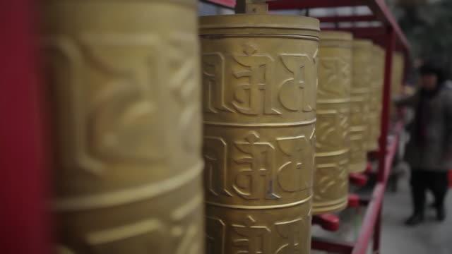 CU Shot of Tibetan Buddhist prayer wheels in temple / Xi'an, Shaanxi, China