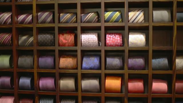 MS TU Shot of Ties rolling up inside store / Potsdam, Brandenburg, Germany