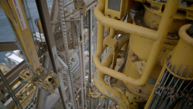 CU Shot of top of machine part being heaved up and down Oil rig in / The North Sea