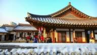 MS T/L Shot of Tourist at Namsan Korean traditional village / Seoul, South Korea