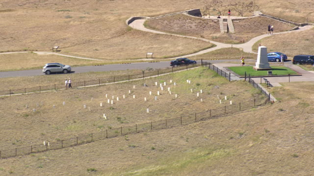 MS AERIAL Shot of tourist enjoying at Battle of Little Bighorn place / Montana, United States