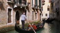 WS Shot of tourist enjoying journey from gondolas, San Marco / Venice, Veneto, Italy